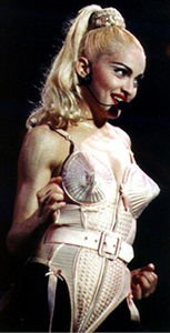 "Madonna tour - Madonna, who canceled the first of three shows in Philadelphia because of a sore throat, sings fefore 14,000 fans during her ""Blonde Ambition"" tour, which also took her to Tokyo and Rome. (AP-Photo/Sean Kardon) 3.12.1990"